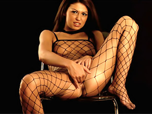 Fishnet Beauty Masturbates on a Chair