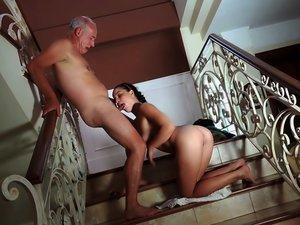 Sexy young lady blows a senior citizen