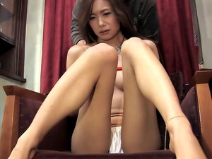 Red rope ties the tits of a cute Japanese girl