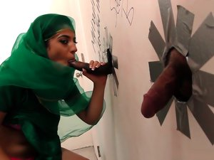 Sexy Arab slut sucks dicks at the gloryhole