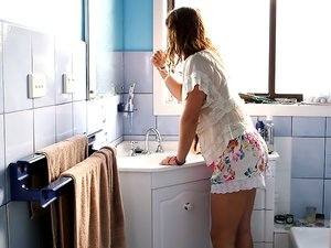 Cute Brunette Teen All Alone in the Bathroom