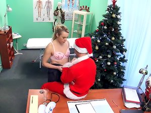 Dirty Santa fucks a cute blonde girl in his office