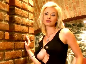 Blonde centerfold beauty fingers her snatch