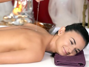 Soft hands give an erotic lesbian massage