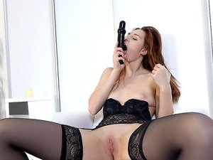 Skinny Redhead Masturbates in Black Stockings