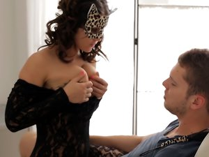 Masked beauty in a lace body stocking sucks dick