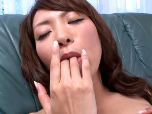 Solo Japanese girl vibrates her pussy until its all wet