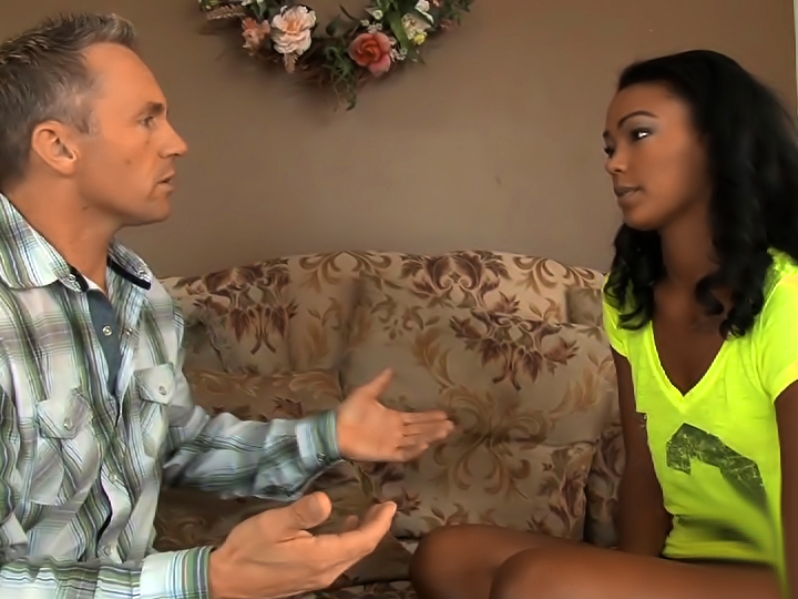 Ebony goddess Harley Dean nailed by muscled stud on the couch.