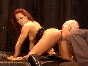 Milf in a latex corset fucked in her hot cunt