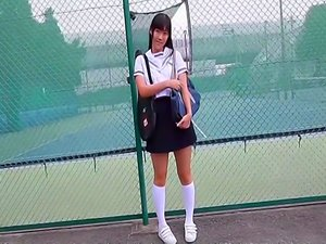 Asian schoolgirl Sae Kamiya strips naked outdoors.
