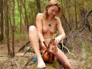 Skinny tramp Billie masturbates in the middle of the forest.