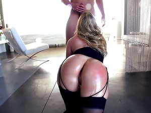Voluptuous blonde AJ Applegate gets oil on her ass and a cock in her holes.