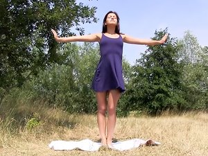 Horny teen Cindy T practices yoga outdoors before masturbating.